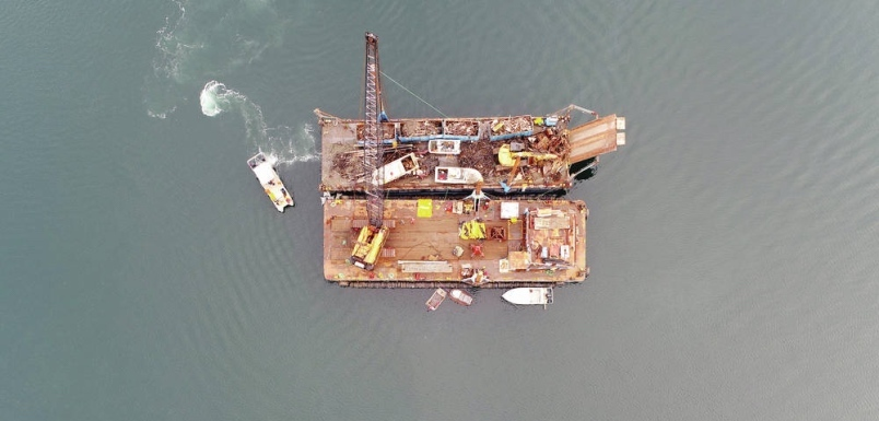 A Salish Sea Industrial Services crane and barges collect boats near Fulford Harbour. GEOFF MULLINS, GKM RESEARCH.